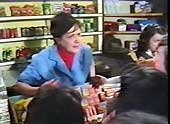 Iona Banks as the sweetshop owner